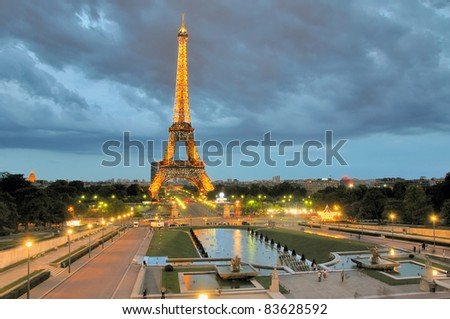 PARIS - AUGUST 22: Eiffel Tower Light Beam Show at dusk on August 22, 2011 in Paris, France. Eiffel Tower is the highest monument in France use 20,000 light bulbs in the show. - stock photo