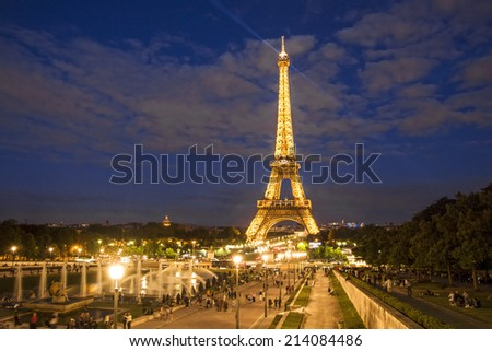 PARIS - August 21: Eiffel tower light show on August 21, 2014 in Paris, France. Eiffel tower stands 324 metres tall. Is the most visited monument in France and use 20,000 light bulbs in the night show - stock photo