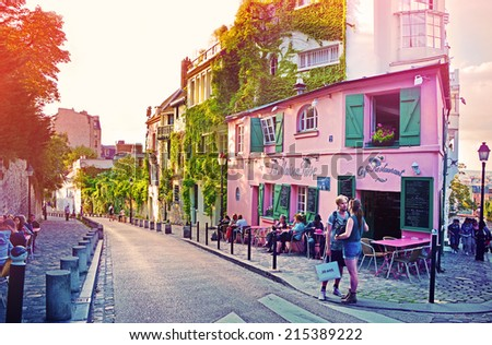 PARIS - August 16: La Maison Rose, a famous cafe restaurent of Montmartre at sunset, all painted in pink on August 16, 2014 in Paris, France - stock photo