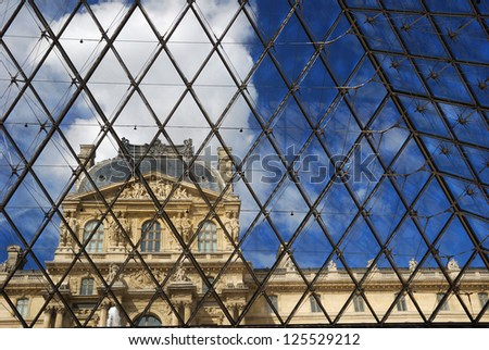 PARIS - AUGUST 17 : Pavillon Rishelieu in Louvre, August 17, 2007, Paris, France. Louvre is the biggest Museum in Paris displayed over 60,000 square meters of exhibition space. - stock photo