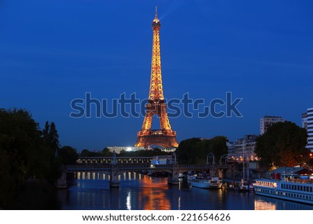 PARIS - AUGUST 27: The illuminated Eiffel Tower on Aug. 27, 2014 in Paris, France.The Eiffel tower is most visited monument of France with 6 million visitors every year - stock photo