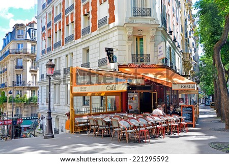 PARIS -August 21: View of typical paris cafe in the artists' quarter of Montmartre on August 21,2014, Paris, France - stock photo