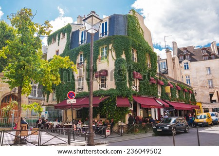 PARIS - August 21, 2014: View of typical paris cafe in the quarter Marais in Paris, France - stock photo