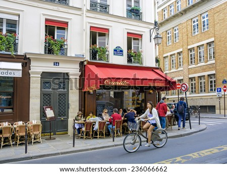 PARIS - August 21, 2014: View of typical paris cafe in the quarter Marais on August 21, 2014 in Paris, France - stock photo