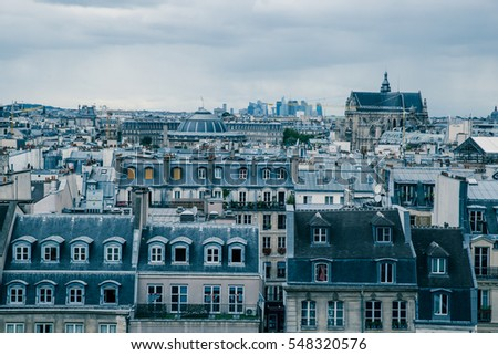 Paris building rooftops on cloudy day
