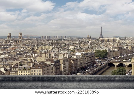 Paris city skyline in daytime with a concrete ground.