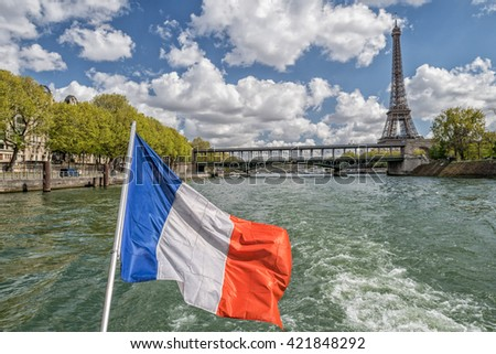 paris cityscape old houses landscape huge panorama view from seine river boat with france national red white and blue waving flag - stock photo