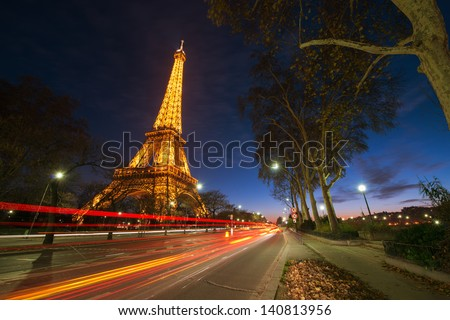 PARIS - DEC 1: Eiffel Tower shows its wonderful lights at sunset with car light trails, December 1, 2012 in Paris. It is lit by more than 350 lamps mounted within the structure of the tower itself