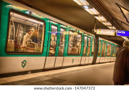 PARIS, DEC 4: Underground train inside a metro station, December 4, 2012 in Paris. Paris Metro is the 2nd largest underground system worldwide by number of stations (300) - stock photo