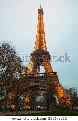 PARIS - December 1: Eiffel Tower and lights in evening dusk on December 1, 2014. The Eiffel tower is the most visited monument of France.