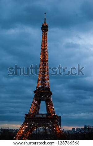 PARIS - DECEMBER 29: Eiffel Tower as seen at evening on December 29, 2012 in Paris, France. The Eiffel tower is the most visited paid monument in the world with over 7 million visitors a year. - stock photo