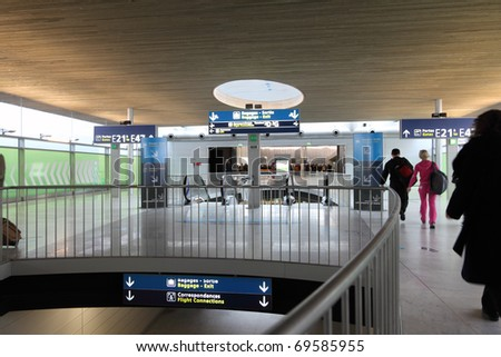 PARIS - DECEMBER 29: Hall of Charles de Gaulle airport, December 29, 2009, Paris, France. Airport is one of largest airports in Europe. Named in honor of Charles de Gaulle, President of France