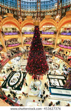 PARIS - DECEMBER 9 2005: The Christmas tree at Galleries Lafayette, trade pavilions with perfume, view from the upper gallery, , Paris, France. This store is one of the symbols of Paris. - stock photo