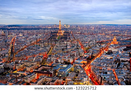 PARIS - DECEMBER 08: View of the Tower Eiffel and Les Invalides on December 08, 2012 in Paris. The Eiffel tower is the most visited monument of France with about 6 million visitors every year. - stock photo