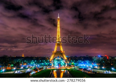 PARIS - DECEMBER 08: View of the Tower Eiffel on December 08, 2012 in Paris. The Eiffel tower is the most visited monument of France with about 6 million visitors every year. - stock photo