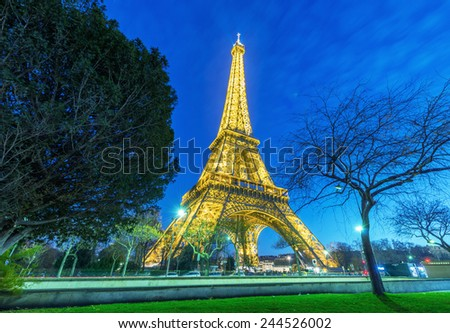 PARIS - DECEMBER 1, 2012: Wonderful night illumination of Tour Eiffel. Eiffel Tower is the most visited monument in France.