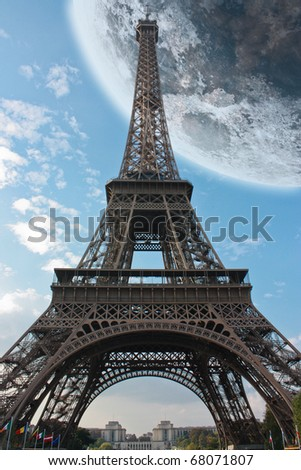 Paris Eiffel Tower France under a big moon - stock photo