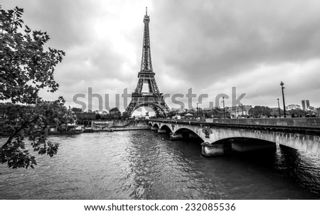 Paris Eiffel Tower from Seine. Cityscape in black and white - stock photo
