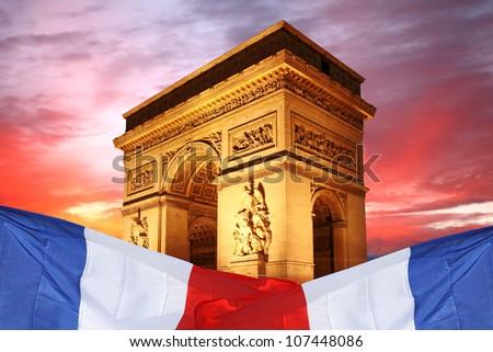 Paris, Famous Arc de Triumph with flag of France - stock photo