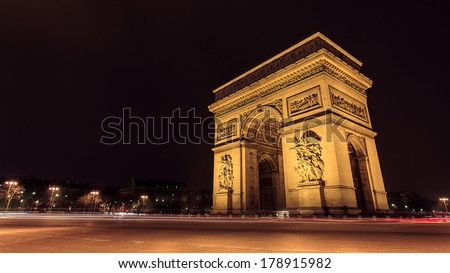 Paris, Famous Arc de Triumph with flag of France - stock photo