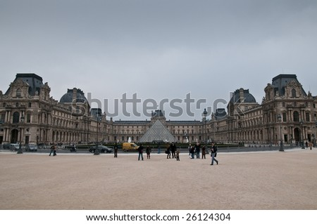 PARIS - FEBRUARY 27: A small crowd visits the Louvre on February 27, 2009 in Paris. - stock photo