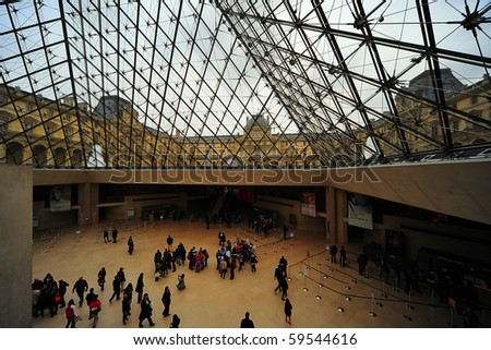 PARIS - FEBRUARY 21: Inside the Louvres pyramid on Feb 21, 2009 in Paris. Louvres is one of the greatest museum in the world - stock photo