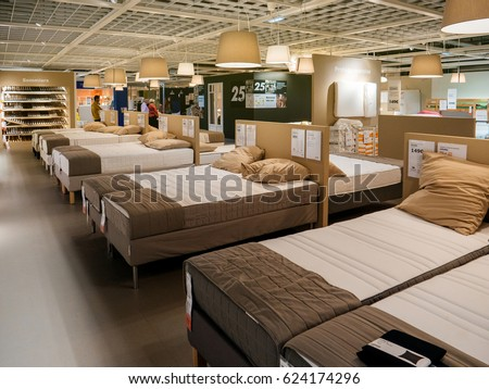 PARIS, FRANCE   APR 10, 2017: Customers Choosing Mattress And Bed Furniture  In