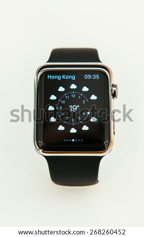PARIS, FRANCE - APR 10, 2015: New wearable computer Apple Watch smartwatch displaying the Weather App. Apple Watch has fitness and health-oriented capabilities and integration with iOS Apple products - stock photo