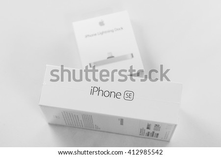 PARIS, FRANCE - APR 21, 2016: Packaging box of the new Apple iPhone SE combining the updated processor, 4K rear camera, touch id, retina display and new Docking Station for iphone - stock photo
