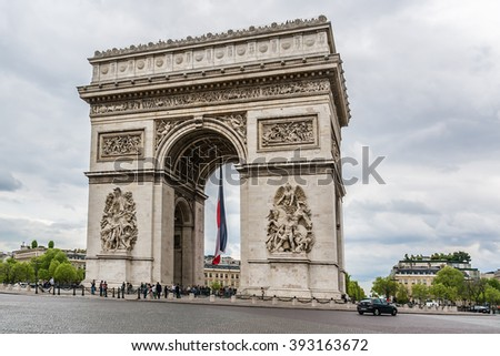 PARIS, FRANCE - APRIL 25, 2015: Arc de Triomphe de l'Etoile on Charles de Gaulle Place, Paris, France. Arc is one of the most famous monuments in Paris.