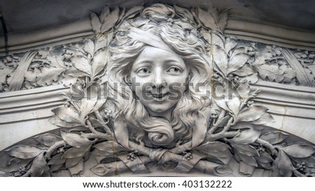 Paris, France - April 5, 2016: Bas-relief in  form of face of a beautiful girl