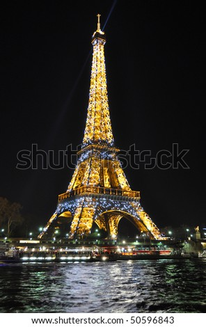 PARIS, FRANCE,  APRIL 4, 2010: Eiffel tower at night. The Eiffel tower is the most visited monument of France. April 4, 2010 in Paris