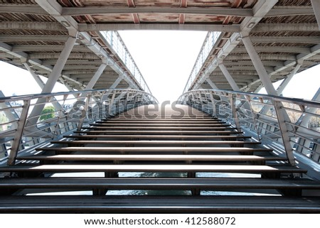 "PARIS, FRANCE - APRIL 18 2016: Enrance to the pedestrian bridge Passerelle Leoopold-Sedar-Senghor. It's former name is ""Passerelle Solferino"". It links Orsay museum and Tuileries Gardens."
