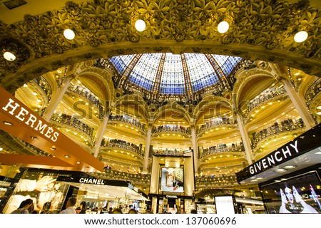 PARIS, FRANCE - APRIL 24 : inside part of the famous Galeries Lafayette with it's brand stands Hermes, Chanel and Givenchy on April 24th 2013 in Paris, France - stock photo