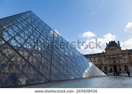 PARIS, FRANCE - APRIL 1, 2015: Louvre Museum with Glass Pyramids, Famous Tourism Landmark on April 1, 2015 in Paris France - stock photo