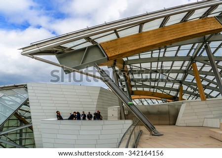 PARIS, FRANCE - APRIL 25, 2015: Modern architecture of Louis Vuitton Foundation (American architect Frank Gehry, 2014). Louis Vuitton Foundation is an art museum and cultural center. - stock photo
