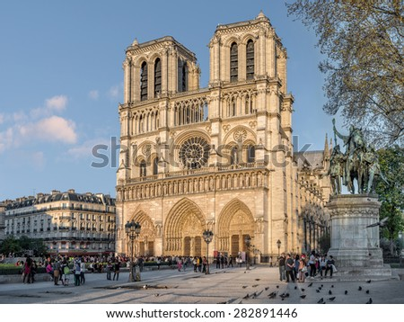 Paris, France - April 15, 2015. Notre-Dame Cathedral in sunset sun rays