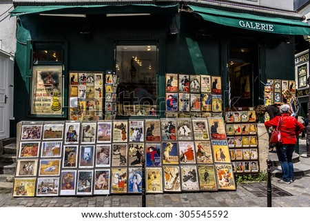 PARIS, FRANCE - APRIL 23, 2015: Old art prints for sale in Montmartre gallery. Charming streets of Montmartre hill are full of art galleries, cafes and shops - one of most visited landmarks in Paris. - stock photo