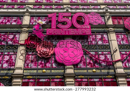 PARIS, FRANCE - APRIL 24, 2015: Printemps (founded in 1865) in Paris - largest beauty Department Store in world with 45000 square meters of shopping. Printemps facade (registered as Historic Monument)