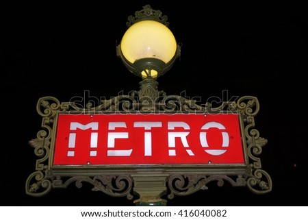 PARIS, FRANCE -12 APRIL 2016- Sign at the entrance of a metro (Metropolitain) subway station in the French capital at night. - stock photo