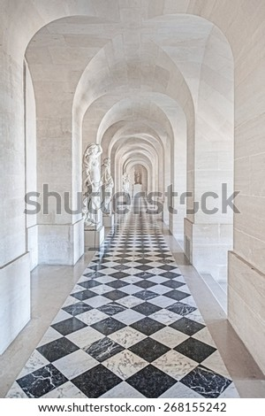 PARIS, FRANCE - APRIL 8, 2015 : The Marble vestibule (Vestibule de Marbre) in the central wing of Palace of Versailles, the residence of the kings Louis XIV, Louis XV and Louis XVI.
