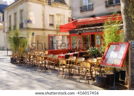 PARIS, FRANCE - APRIL 20 2016:Traditional restaurant on Quai de la Tournelle waits for the first visitors. The street is popular with tourists enjoying view of Notre Dame Cathedral. - stock photo