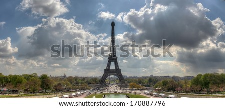 PARIS, FRANCE - APRIL 12, 2012: View at Eiffel tower in Paris. The tower is the tallest structure in Paris and most-visited paid monument in the world, he received its 250 millionth visitor in 2010. - stock photo