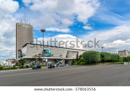 PARIS, FRANCE - APRIL 25, 2015: View of Congress Palace (Palais des congres) and Hyatt Regency Paris Etoile (on background) - skyscraper hotel located near Porte Maillot.