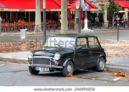 PARIS, FRANCE - AUGUST 8, 2014: Classic british compact car Austin Mini Cooper at the city street. - stock photo