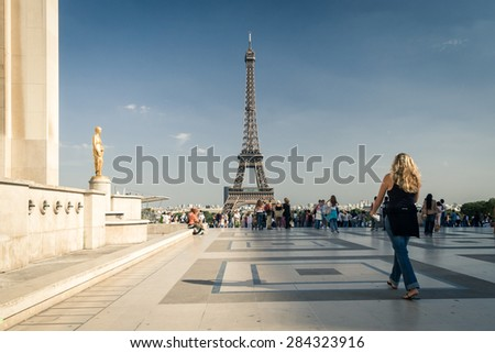 PARIS, FRANCE - AUGUST 31:  Late afternoon on famous square Trocadero with Eiffel tower in the background on August 31, 2006. Trocadero and Eiffel tower are the most visited attractions of Paris. - stock photo