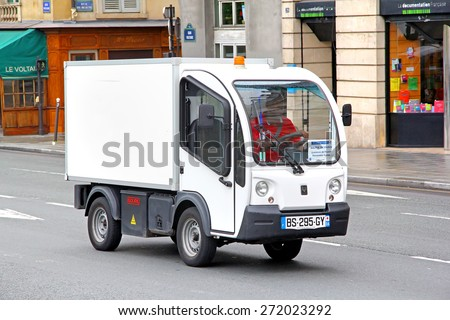 PARIS, FRANCE - AUGUST 8, 2014: Mini electric cargo truck Goupil G3 at the city street.