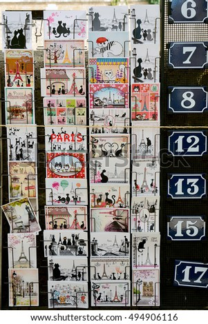 PARIS, FRANCE -  August 18, 2014: Old retro postcards with images of symbols of Paris Eiffel Tower and the Black Cats for sale in Montmartre gallery.