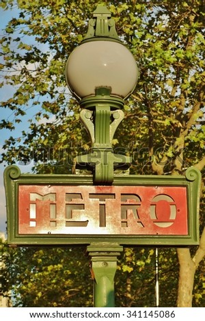 PARIS, FRANCE -17 AUGUST 2015- Sign at the entrance of a metro (Metropolitain) subway station in the French capital. - stock photo