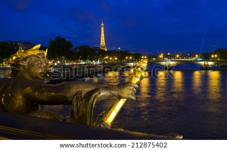 PARIS, FRANCE - AUGUST 6TH 2014: A view from Pont Alexandre III, taking in the sights of the Eiffel Tower and Pont des Invalides in Paris on 6th August 2014. - stock photo